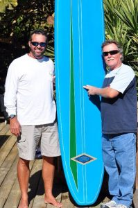 Eddie Legge and Doug Moore. Doug's replica of his first surfboard.