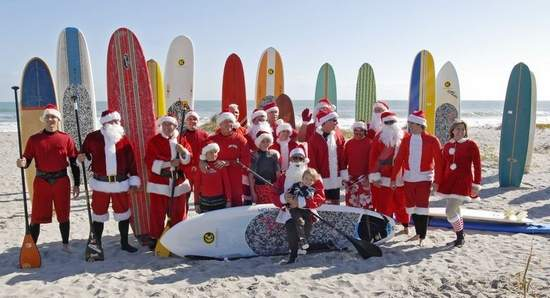 Surfing Santas at the beach house 2010. Doug's board is 4th from the right, in wrapping paper.